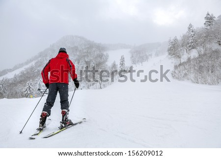 skier man moving up in a snowy