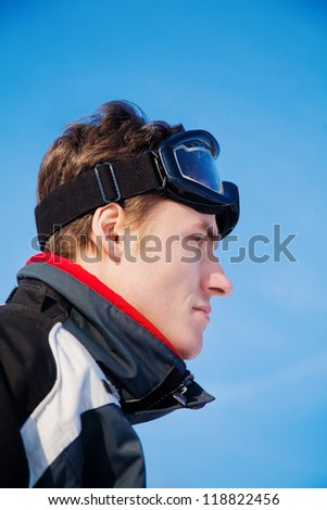 Skier man portrait sky background - stock photo