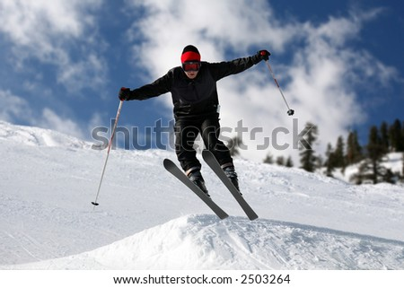 Skier on a slope against the cloudy sky - stock photo