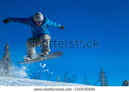 Skier on off-piste slope in forest riding very fast. Ski backcountry resort Sheregesh.