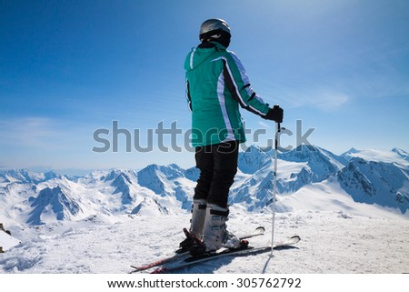 skier on snow hill in Solden, Austria, extreme winter sport