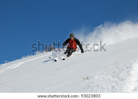 Skier on the hill - stock photo