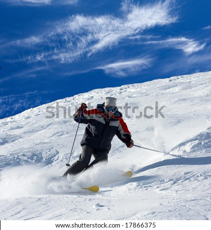Skier rush with clouds of snow powder