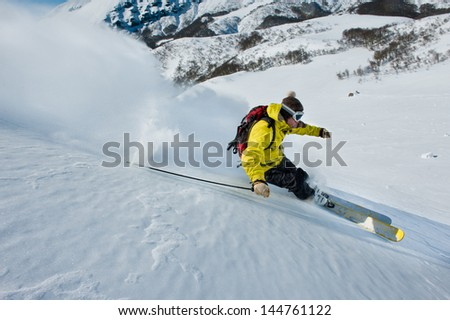 Skier skidding in the snow, off piste. - stock photo