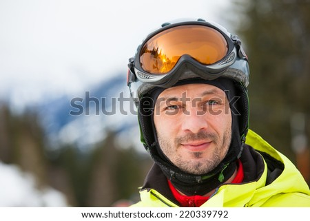 Skier, skiing, winter sport - portrait of male skier - stock photo