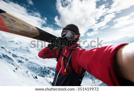 Skier takes a Selfie - stock photo