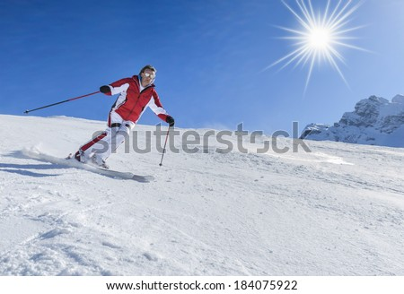 Skier with sun and mountains - stock photo
