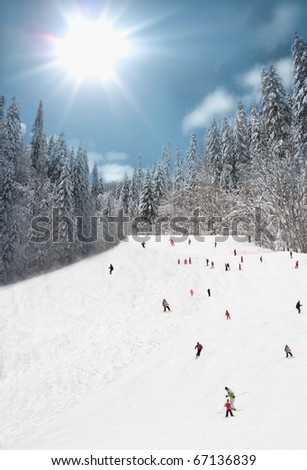 Skiers in Busy Ski Resort - stock photo