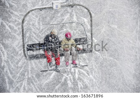 skiers in the snow - stock photo