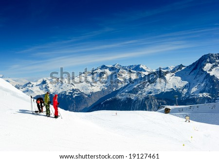 Skiers on the top of the mountain in Meribel Valley at French Alps - stock photo