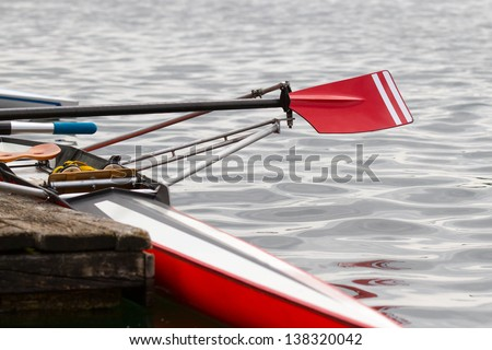 Skiff at the landing stage - stock photo