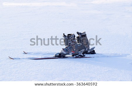Skiing equipment on white snow at the day