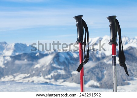 skiing in mountains, close up of two ski poles - stock photo