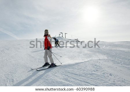 Skiing in the mountains, female skier - stock photo