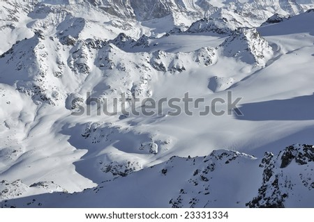 skiing in the wilderness in the swiss alps - stock photo