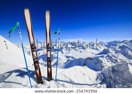 Skiing , mountains and ski equipments on ski run - stock photo