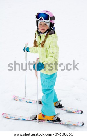 Skiing, portrait of young skier on ski slope - stock photo