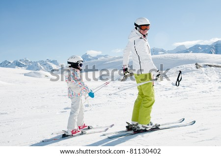 Skiing - ski lesson in winter resort