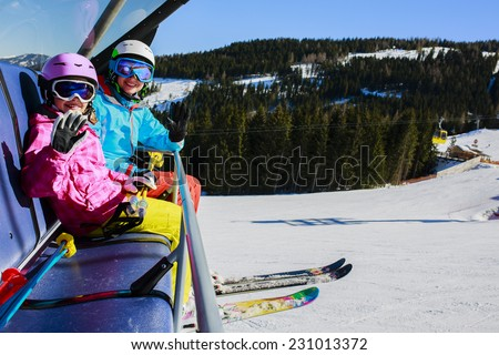 Skiing, ski lift. Skiers enjoying winter vacation - stock photo