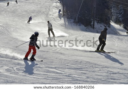 Skiing, Skier, Freeride at groomed slopes -  skiing downhill at Cannon mountain , NH - stock photo