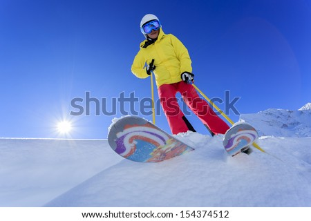 Skiing, Skier, Freeride in fresh powder snow - woman skiing  - stock photo