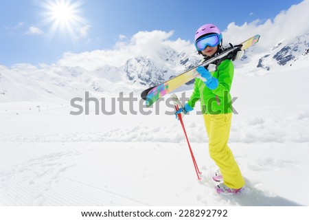 Skiing, skier, winter fun - lovely skier girl enjoying ski vacation - stock photo
