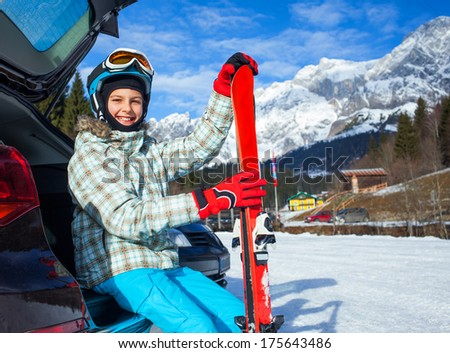 Skiing, skier, winter sports - portrait of happy young skier near car. - stock photo