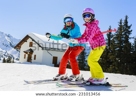Skiing. Skiers enjoying winter vacation - stock photo