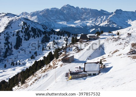 Skiing slope in the Dolomite Alps valley, Italy - stock photo
