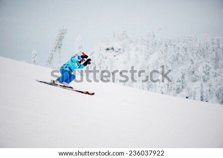 Skiing, winter, child -  young  girl skier in winter resort - stock photo