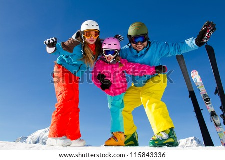 Skiing, winter fun - family ski team enjoying ski holidays - stock photo
