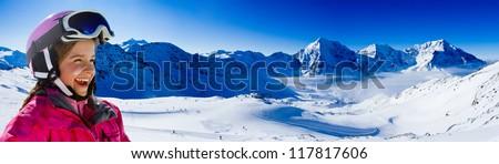 Skiing, winter fun, ski billboard - lovely skier girl enjoying the snow - stock photo