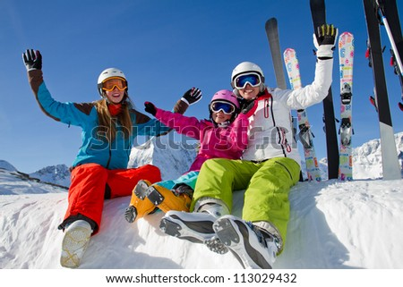 Skiing, winter holidays -  happy  skiers enjoying winter vacation - stock photo