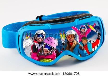 Skiing,winter - reflection of the portrait of the family in ski goggles