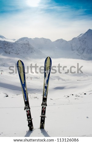 Skiing, winter season , mountains and ski equipment in the snow, - stock photo