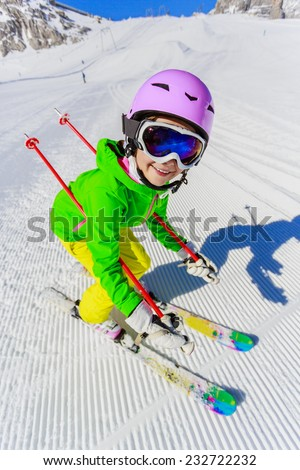 Skiing, winter, ski lesson - young skier on ski run - stock photo