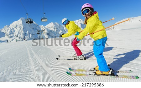 Skiing, winter sport, ski lesson - happy skiers on mountainside - stock photo