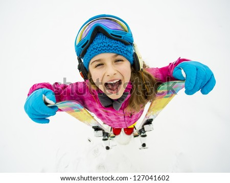 Skiing, winter sports, winter fun - portrait of young skier - stock photo