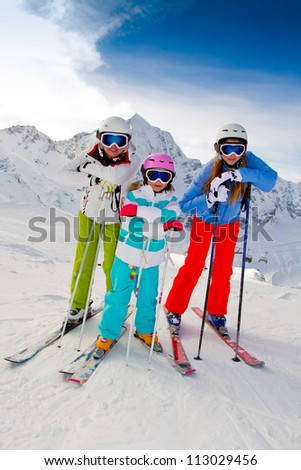 Skiing, winter vacation -  happy female skiers - stock photo