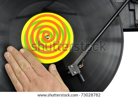 Skilled DJ perform scratching technique on turntable and vinyl record - stock photo