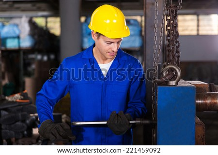 skilled manual worker working in workshop - stock photo