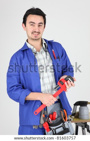 skilled technician with tools - stock photo