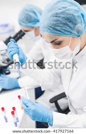 Skillful two researchers are testing virus in lab