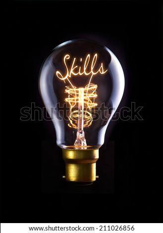 Skills concept in a filament lightbulb. - stock photo