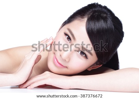 Skin care beauty woman face Smile to you close up while lying isolated on white background, asian girl - stock photo