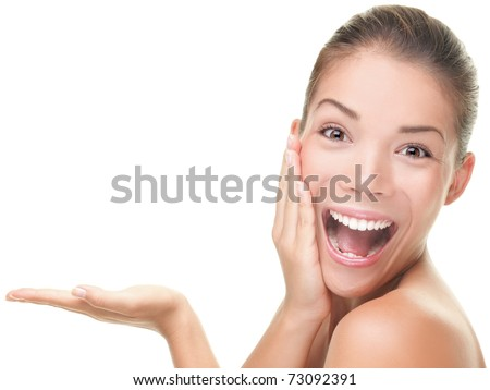 Skin care beauty woman showing empty palm with copy space for product. Excited and very fresh smiling mixed race Asian Caucasian female beauty model isolated on white background. - stock photo