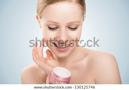 skin care. face of a happy beauty healthy girl with eyes closed with jar of - stock photo