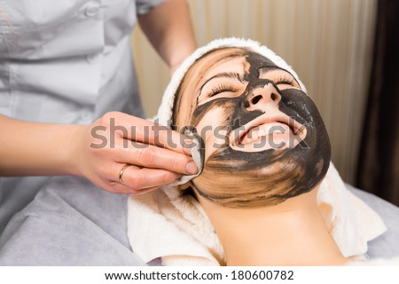skin care, medical beautician removes the mask from the face of the girl