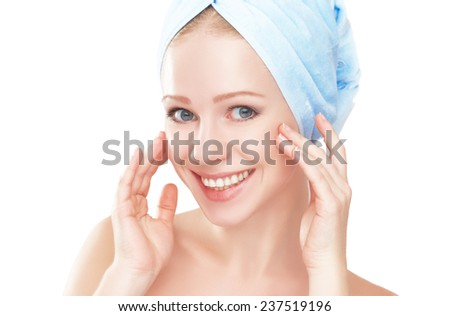 skin care. young beautiful healthy girl in a towel in the bathroom - stock photo