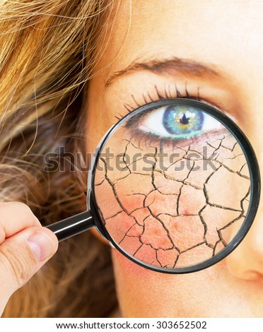 Skin folds under a magnifier glass - stock photo